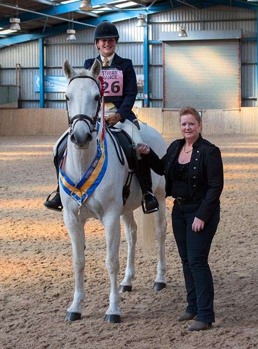 Natasha Miller receives her prize from Lorraine Meadowcroft of EquestrianClearance.com