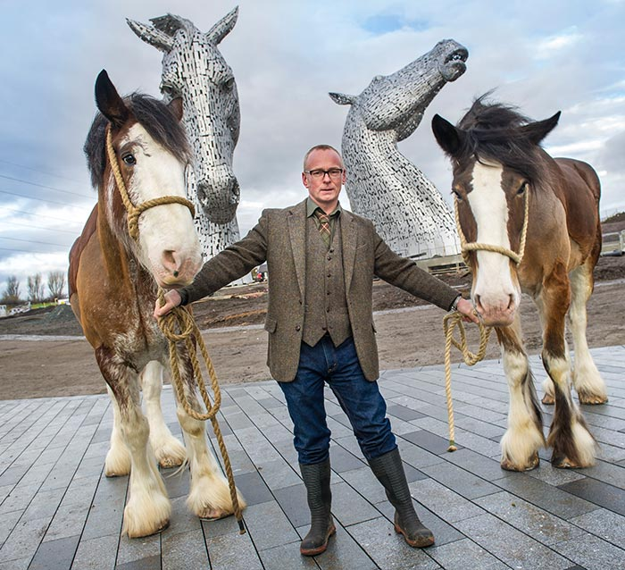Sculptor Andy Scott with Clydesdales, Duke and Baron at the unveiling of the Kelpies